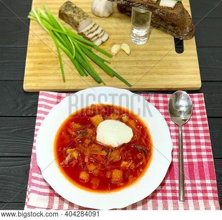 Borsch Lard And Vodka In A Glass On The Table. Sandwich Of Black Bread And Lard. Traditional Ukraini