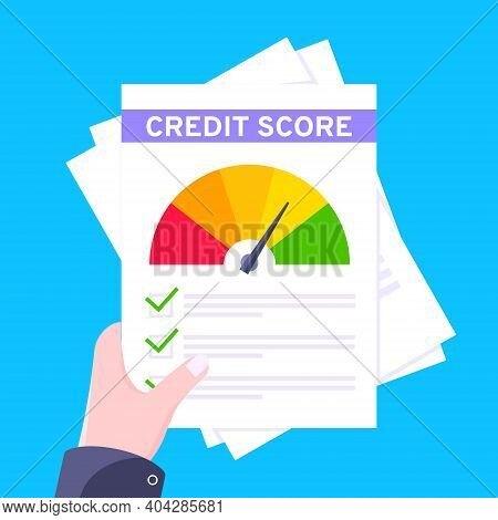 Hand Holds Credit Score Gauge Speedometer Indicator With Color Levels On Paper Sheets And File. Meas