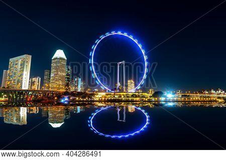 Beautiful Singapore Cityscape At Dusk. Landscape Of Singapore Business Building Around Marina Bay. M