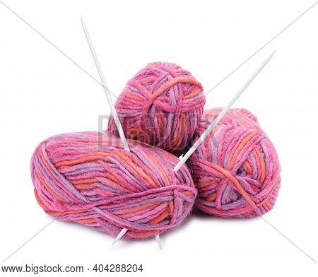 Group Of Hanks Of Colored Yarns And Knitting Needles Isolated On White Background.