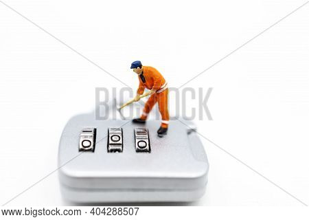 Miniature People: Worker Hacking In Padlock Security. Concept For Data Security Breach, Risk And Hac