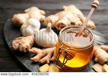 Ginger, Honey And Garlic On Black Table, Closeup. Natural Cold Remedies