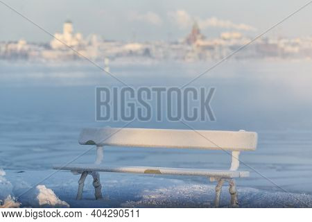 Traditional Wooden And Frosty Resting Bench In Helsinki, Finland  On Extremely Cold Winter Morning W