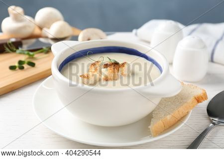 Delicious Cream Soup With Croutons On White Wooden Table