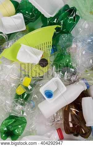 Various Plastic Waste, Bottles, Pet, Eggplants, Plastic Cups And Household Items. Top View