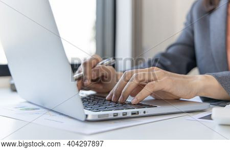 Close-up of a woman's hand pressing on the laptop keyboard,World of technology and internet communic