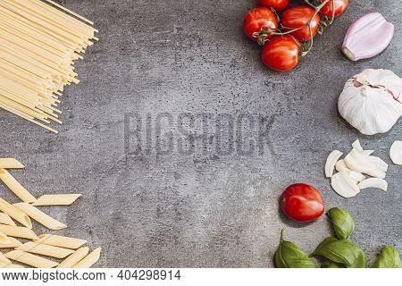 Italian Food Ingredients. Vegetables, Pasta On Dark Background. Italian Cuisine