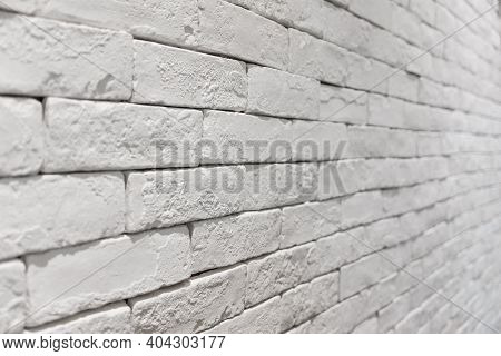Side View Of Empty White Brick Wall In Room. Textured And Background