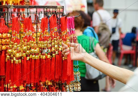 Old Women Holding Chinese New Year Talisman Gift Decoration For Celebrate Year Of The Rat. For Good
