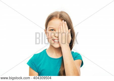 Smiling Child Closing Eye With Her Hand For Checking Vision, Isolated On White Background. Vision Te