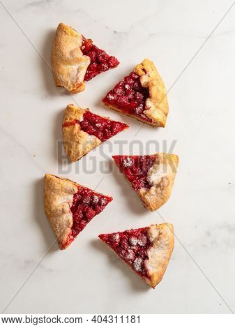 Perfect Slices Of Raspberry Galette. Delicious Rustic Homemade Tart With Frozen Or Fresh Raspberries