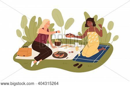 Happy Female Friends Relaxing On Picnic Blanket In Summer. Two Women Spending Leisure Time Together
