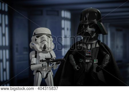 JAN 20 2021: humorous concept of a big head Darth Vader and Stormtooper - Star Wars humor - Hasbro action figure