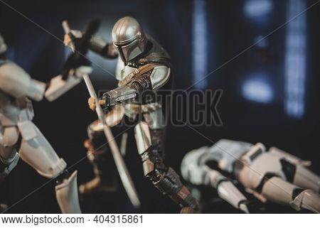 JAN 20 2021: scene from Disney Plus series The Mandalorian  battling Stormtroopers with a beskar staff - Hasbro action figure