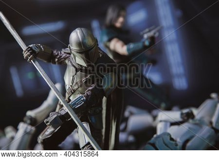 JAN 20 2021: scene from Disney Plus series The Mandalorian  battling Stormtroopers with a beskar staff with Cara Dune in the background - Hasbro action figure