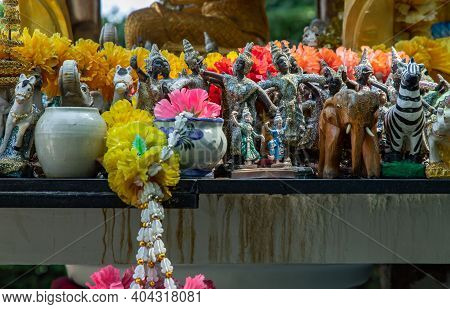 Thai Dancing Dolls, Zebra Doll And Wooden Elephant Doll In The Thao Maha Phrom Shrineis. Selective F