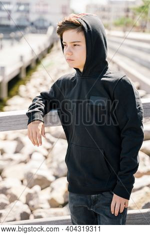 Portrait Of Teenager Outdoors On Blurred Background