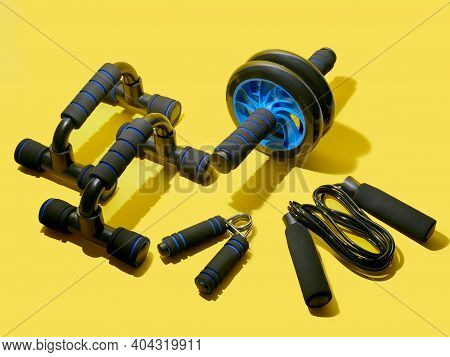 Flat Lay Of Sport And Fitness Equipment On Yellow Background With Copy Space. Illuminating Stay Home