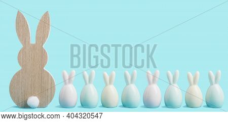 Happy Easter Banner. Colorful Easter Rabbits On Blue Pastel Background. Easter Greeting Card Or Web