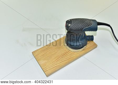Electric Wood Sander On A Wooden Product. Woodworking Tool Concept. Furniture Metal Polisher, Dander