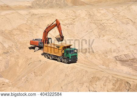 Excavator Load The Sand Into Dump Truck In Open-pit Mining. Developing The Sand In The Opencast, Pro