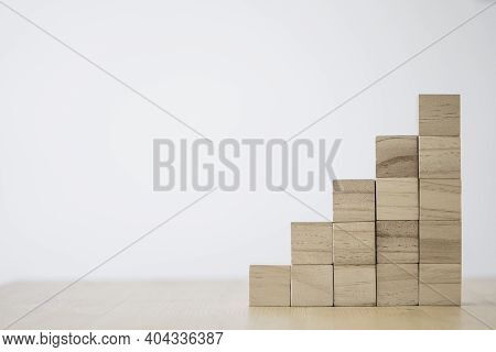Stacking Of Blank Wooden Cubes On Table With Copy Space For Input Wording And Infographic Icon.