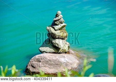 A Stone Sculpture Stands In Seawater.a Stone Sculpture .