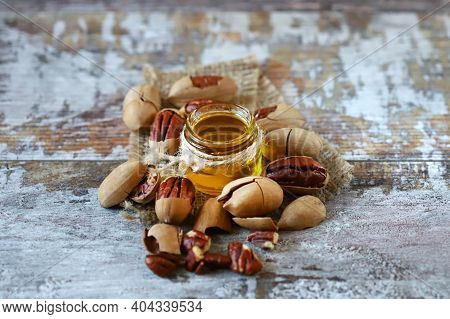 Selective Focus. Macro. Pecan Oil. Pecans, Shelled And In Shell.