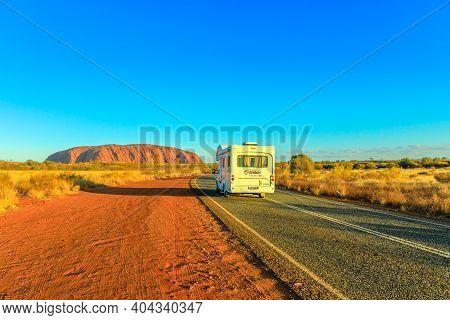 Uluru, Northern Territory, Australia - Aug 25, 2019: Camper Van Driving On The Road Leading To Uluru