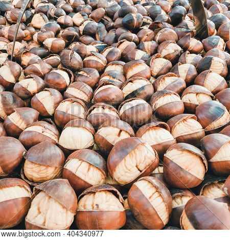 Street Food Market. Roasting Brown Chestnuts. Tasteful Roasted Chestnuts For Sale - Rome, Italy