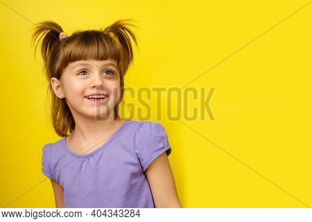 Portrait Of Smiling Little Caucasian Girl With Pigtails And Bruise Under The Eye And Looks Away. Cop