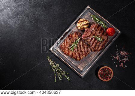 Fresh Juicy Delicious Beef Steak On A Dark Background