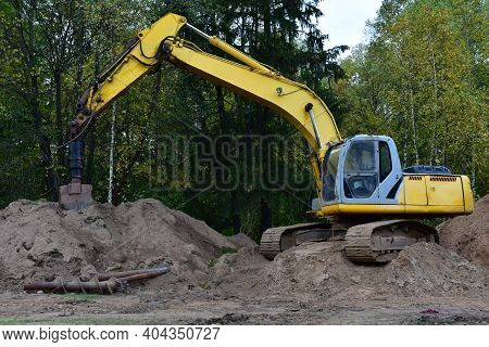 Excavator With Vertical Tamrock Pile Foundation Drilling Machine. Drill Rig At Forest Area. Ground I