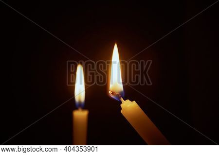 The Lighting Candles, Burning Candle On Black Background, Candlelit In The Dark, Candle Flame At Nig