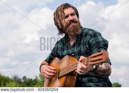 Favorite Tune. Country Music Concept. Bearded Man Play Acoustic Guitar. Casual Guy Express Human Emo