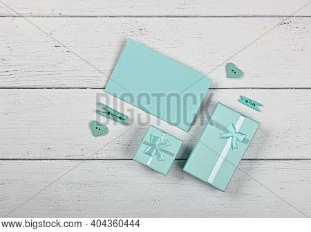 Valentine Template Of Teal Mint Color Gift Boxes With Ribbon Chiffon Bows And Paper Note On White Wo