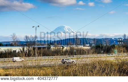 A View Of A Freeway With Mount Rainier In The Distance In Auburn, Washington.