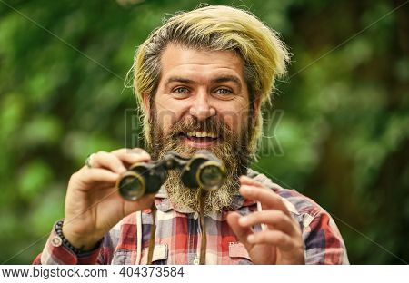 Tourism Summer Vacation. Hobby And Leisure. Hipster Tourist Holds Binoculars Nature Background. Obse