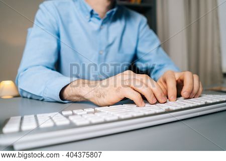 Close-up View Of Hands Of Unrecognizable Man Using Computer And Typing Online Message On Wireless Ke