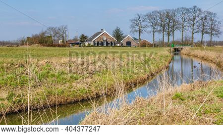 Gelderland, Netherlands - March 24, 2018: Typical Dutch Farmhouse On The Dutch Countryside