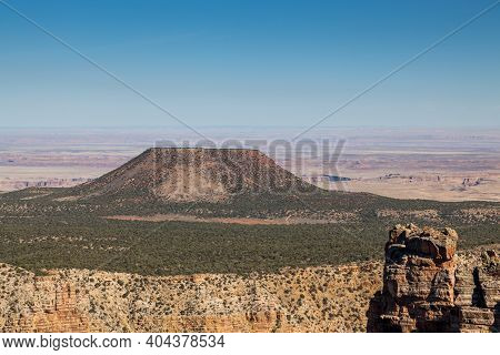 A Large Butte Of Land Called Cedar Mountain Rising Up Past The Level Upper Landscape And Covered In