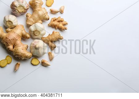 Ginger And Garlic On White Table, Flat Lay With Space For Text. Natural Cold Remedies
