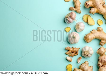 Ginger And Garlic On Turquoise Table, Flat Lay With Space For Text. Natural Cold Remedies