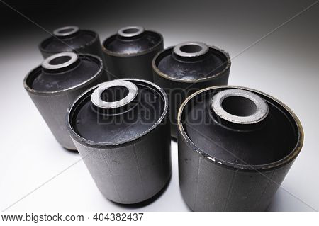 Close-up. A Group Of Cylindrical Silent Blocks For The Rear Suspension Of An Off-road Vehicle. Contr