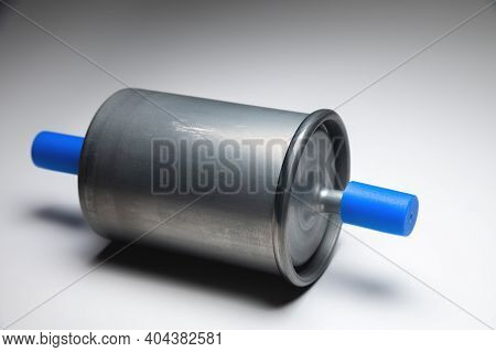 New Fuel Filter For Gasoline Internal Combustion Engine With Blue Caps On A Gray Background. New Spa