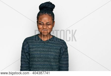 Young african american woman wearing casual clothes puffing cheeks with funny face. mouth inflated with air, crazy expression.