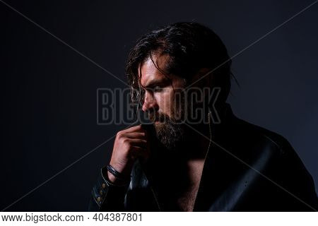 Biker In Lether Jacket. Brutal Bearded Man. Silhouette Of Handsome Man. Barber Shop. Pensive Man. Bl