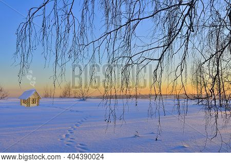 Wooden Toy House On Snowy Winter Background In Warm Light Of Sunrise. New Year And Christmas Holiday