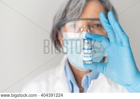 Portrait Of A Scientist Or Senior Female Doctor, Who Representative In Medical Latex Gloves Holding