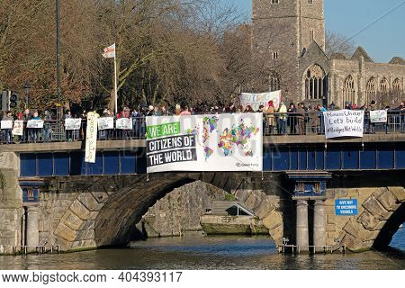 Bristol, Uk - January 20, 2017: Demonstrators Protest Against The Policies Of Us President Donald Tr